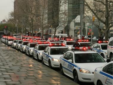 Eighty police cars will gather outside UN Headquarters Friday for a