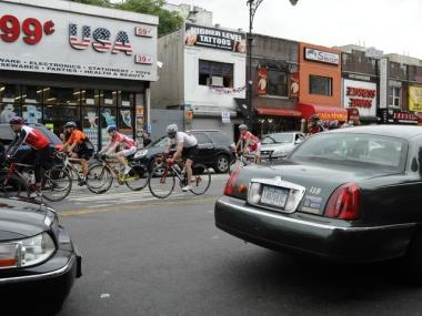 Cyclists riding on Dyckman Street.