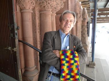Pastor Bob Brashear of West-Park Presbyterian, with the rainbow stole he once wore at national church meetings to symbolize gays and lesbians who couldn't be ordained.