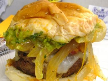 The Tijuana burger comes with jack cheese, bacon, guacamole and sauteed onions.