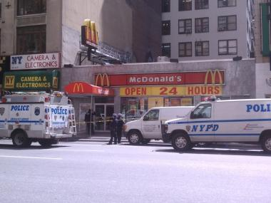 Police cordon off a McDonalds on Eighth Avenue between 34th and 35th after a man was stabbed there.