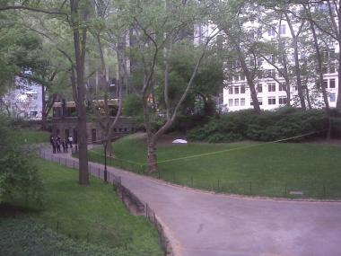 A dead body lies in the grass near Central Park West and 63rd Street Friday morning.