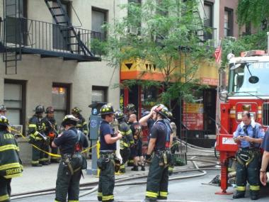 Firefighters work to fight the two-alarm blaze at Third Avenue and E. 24th Street.