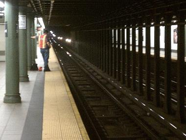 The scene on the platform at the E. 77th Street Station where a young woman was struck and killed by a subway train.