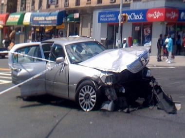 Wreckage of one car involved in crash that killed an elderly woman at W. 145th Street and Seventh Avenue in Harlem.