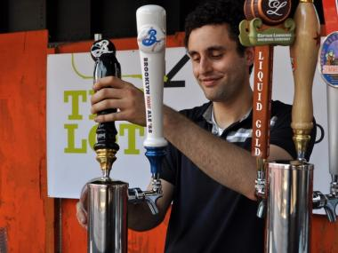 Chase Rabenn, assistant beer director with Colicchio and Sons, poured beer at the Lot on Tap.