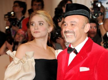 Actress Ashley Olsen and Designer Christian Louboutin attend the 'Alexander McQueen: Savage Beauty' Costume Institute Gala at The Metropolitan Museum of Art on May 2, 2011.