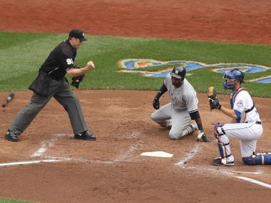Josh Thole tags out Eduardo Nunez during the second game of the Subway Series on July 2, 2011.