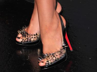 Christina Aguilera wears Louboutins at NBC's press conference for the their new Show 'The Voice' on March 15, 2011 in Los Angeles, California.