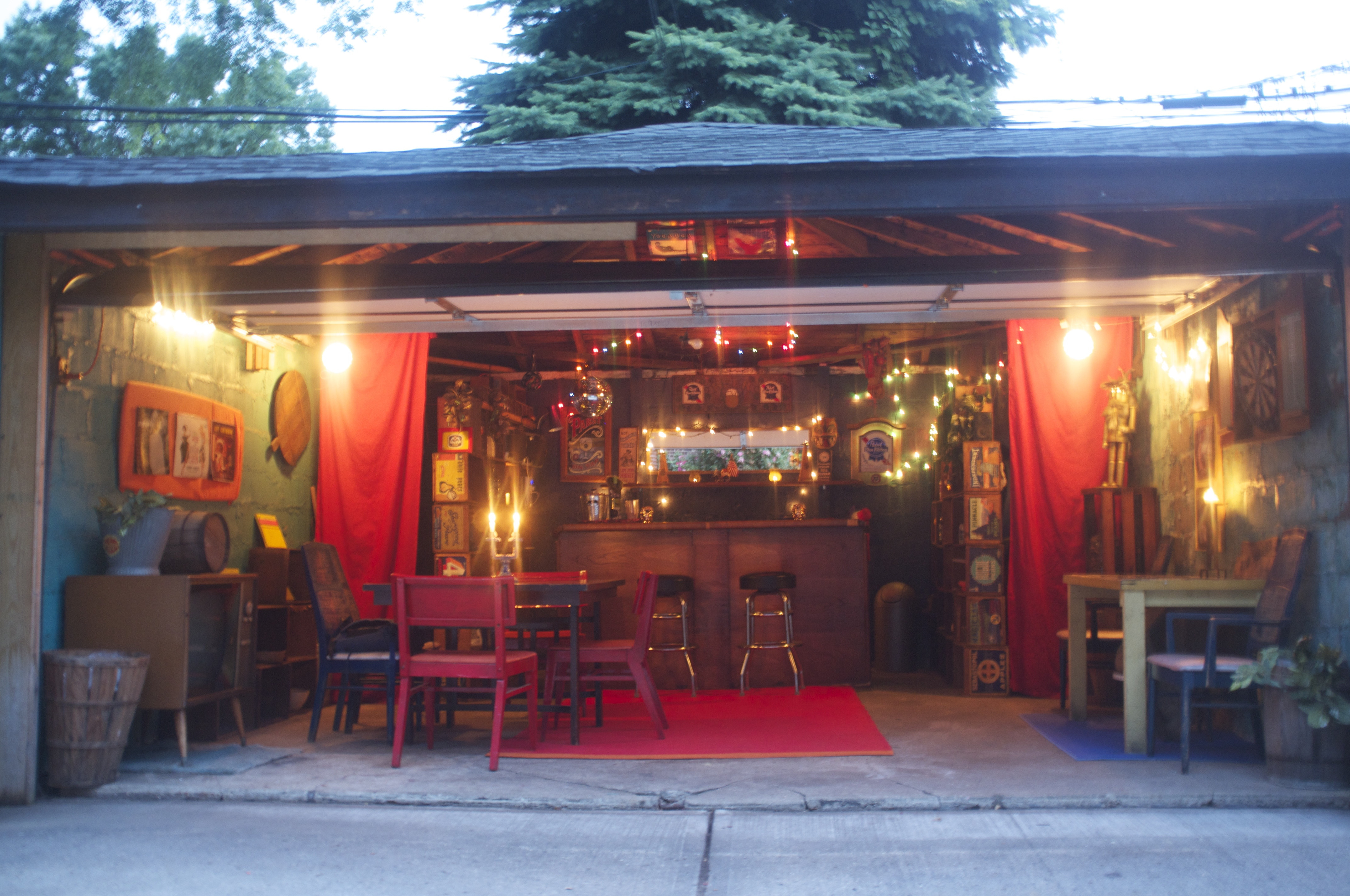 ideas for outside metal decor over garage - East Elmhurst Couple Turns Garage Into Funky Tiki Bar