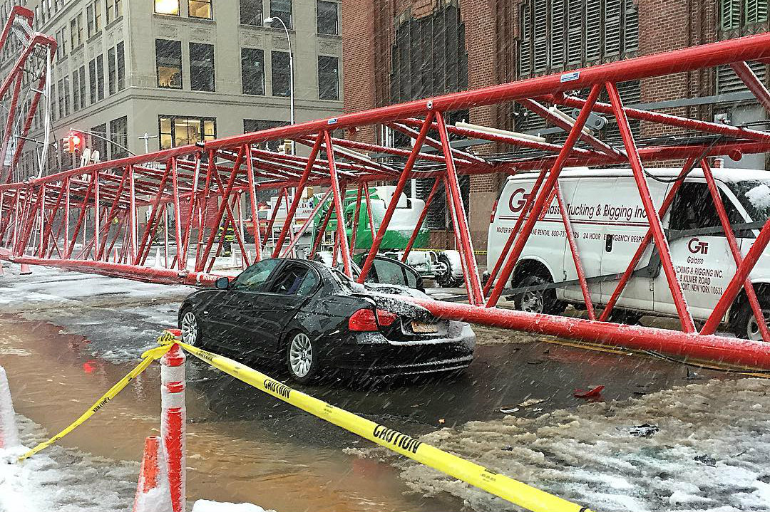Collapsed construction crane removed from NYC street