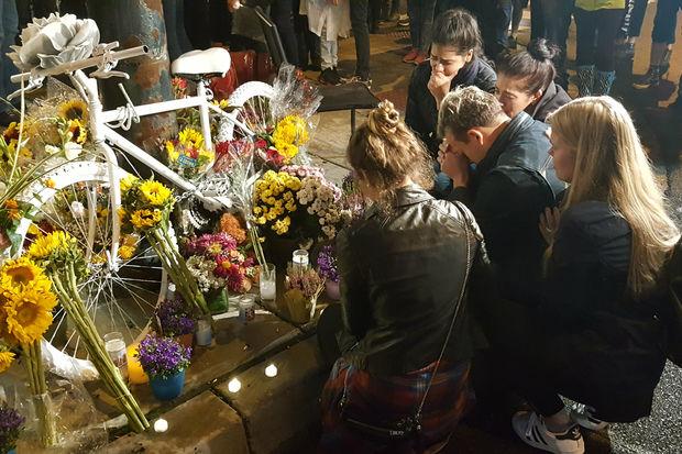 The vigil was held at the intersection whereAnastasia Kondrasheva, 23, was fatally hit.