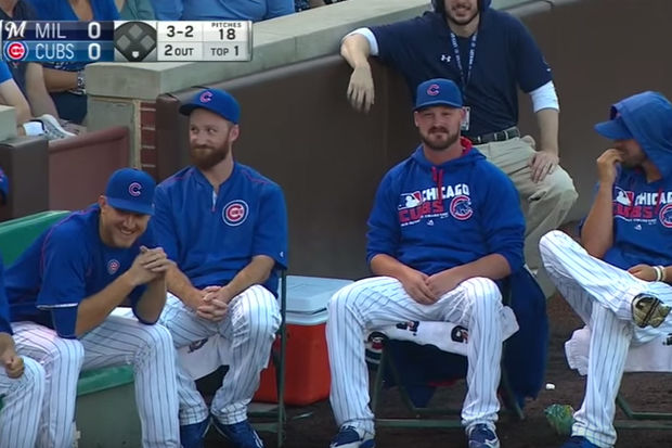 The Chicago Cubs bullpen pitchers try to keep straight faces after a foul ball ricocheted past them and no one moved as part of their