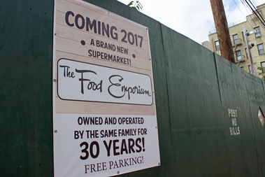 A sign at the site says the new market will open in 2017 and have free parking.