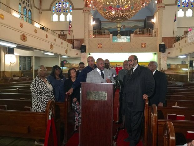 A dozen Harlem pastors gathered Tuesday to raise concerns about the company that could equip the NYPD with body cameras.