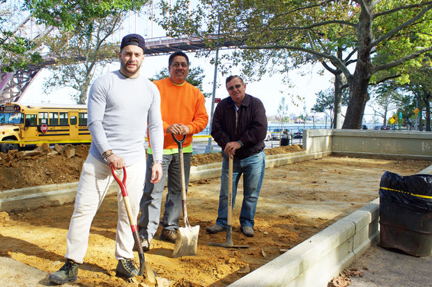 Volunteers (left to right) Roy Meza, Dan Berrios and Mimmo are working to restore the bocce court in Astoria Park.