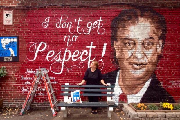Italian artist Francesca Tosca Robicci works on a mural depicting late stand-up comedian and actor Rodney Dangerfield in Kew Gardens.