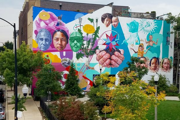 A new mural by Jeff Zimmermann along the south wall of a building at 1813 N. Milwaukee Ave.