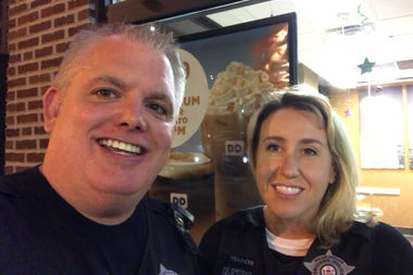Sgt. Bob Kane and Officer Nicole Trainor appear in a Facebook Live video on the Chicago Police Department's page. The two News Affairs officers are leading the department's more proactive approach to social media.