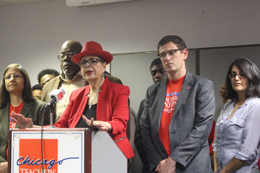 Chicago Teachers Union President Karen Lewis said teachers would not accept any new cuts in pay or benefits. Vice President Jesse Sharkey (right) said talks would continue through the weekend.