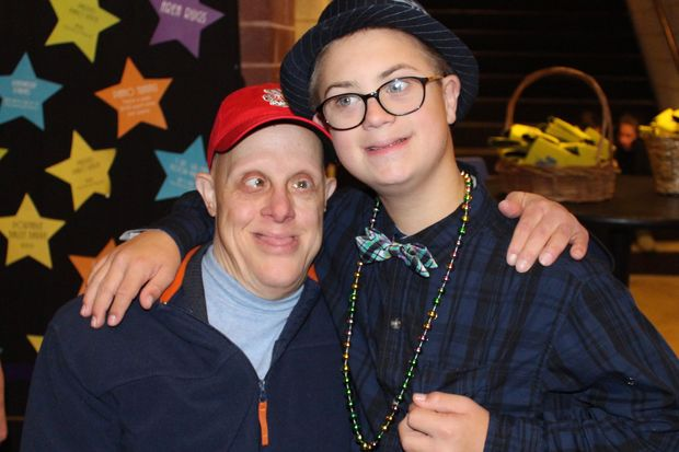 Nate Simon (right) stands beside a fellow attendee of HollyDays. The fundraiser was started by Nate's mom, Holly and funds her I Am Who I Am charity.