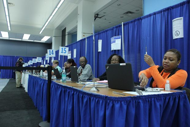 """The """"super site,"""" which opened Monday, employs 32 people and houses 150 voting machines, officials said."""