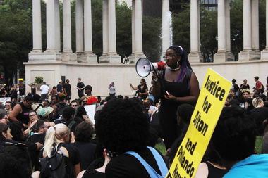 Payton College Prep student Eva Lewis helped organize a silent protest in July at Millennium Park.