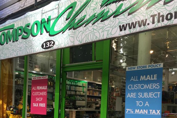 Signs in the window of Thompson Chemists say male customers will be charged a 7 percent