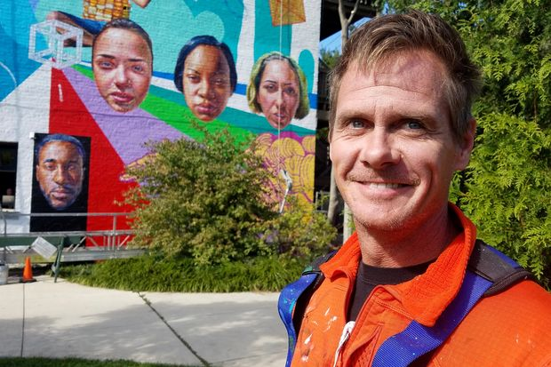 Muralist Jeff Zimmermann in front of his latest work commissioned by ConAgra Brands.