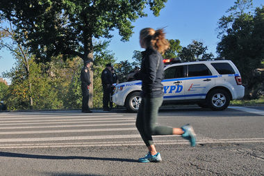 A jogger runs on East Drive in Central Park where a female runner was nearly raped Monday night, police said.