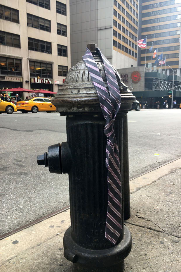 A person apparently got fed up and left a tie hanging on a fire hydrant in Midtown on Thursday, Oct. 14, 2016.