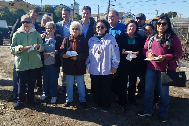 Neighbors and officials gathered to help break ground on a Lou Malnati's slated to open near Midway Airport.