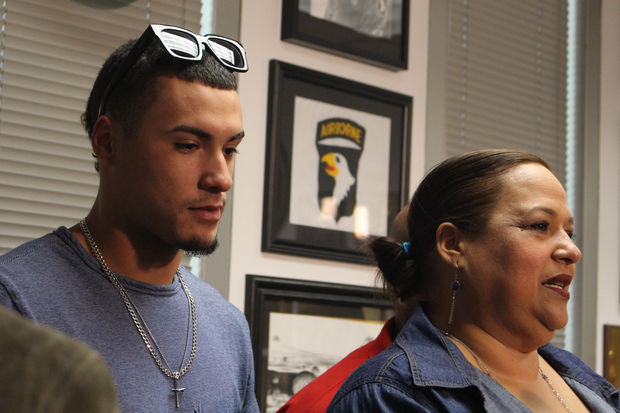 Javy Baez's mother, Nelida, expresses pride in her son at Friday's award ceremony.