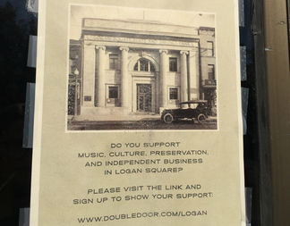 A flyer posted to the Logan Square building.
