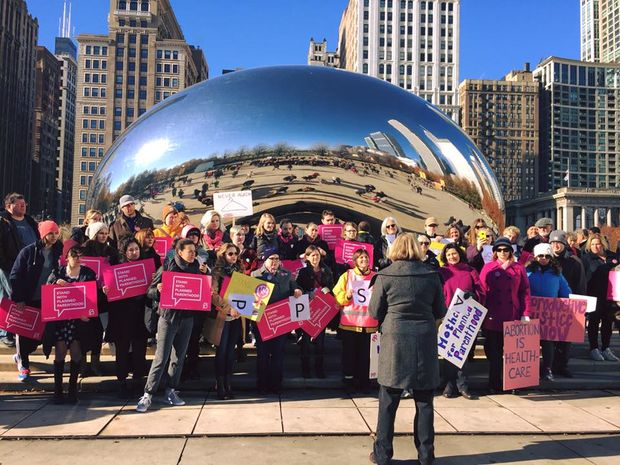 Supporters of Planned Parenthood take a photo at The Bean in 2015.