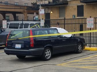 A car in a Walgreens lot at 1373 N. Milwaukee Ave.