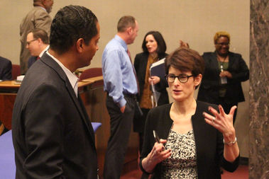 Ald. Anthony Beale and Budget Director Alexandra Holt talk before Monday's City Council hearing.