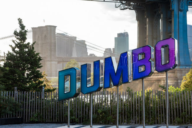 The DUMBO Reflector will illuminate according to different social media hashtags, as well as give the time, weather and traffic updates.