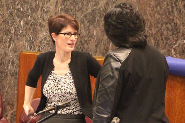 Budget Director Alexandra Holt talks with Ald. Michelle Harris at the close of Monday's opening 2017 budget hearing.