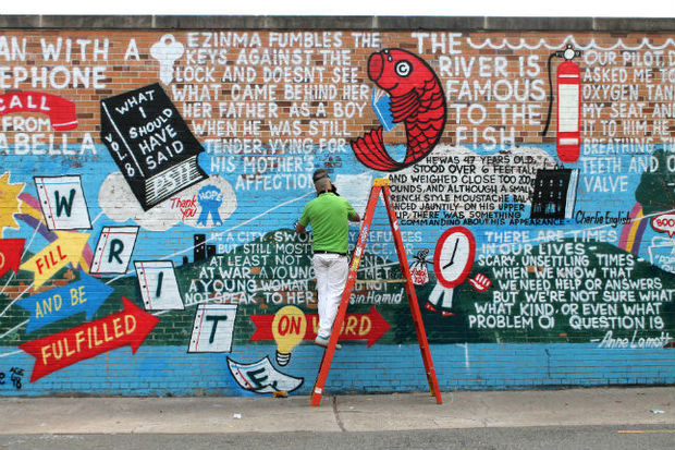 The mural features the opening lines from 12 new titles published by Riverhead Books.