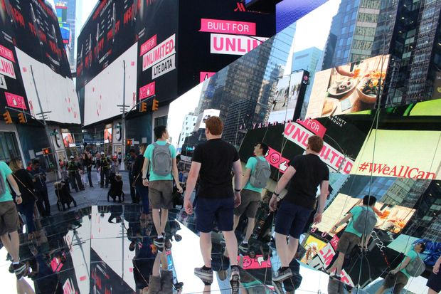 """Pedestrians can walk through a """"human kaleidoscope"""" in the Crossroads of the World for the next month."""