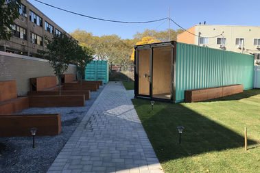 A youth and community clubhouse made from re-designed shipping containers takes over a vacant lot on Chester Street and Dumont Avenue in Brownsville and debuts on Oct. 19.