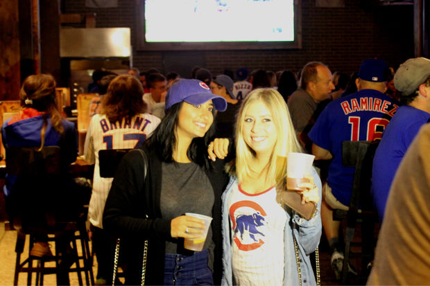Fans take in the early game action at Old Crow on Clark Street in Wrigleyville Tuesday.
