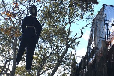 Residents spotted the dummy swinging from a tree on Orient Ave. on Wednesday.