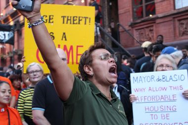 Organizer Tammy Rivera of the NYC District Council of Carpenters led protesters in chants of