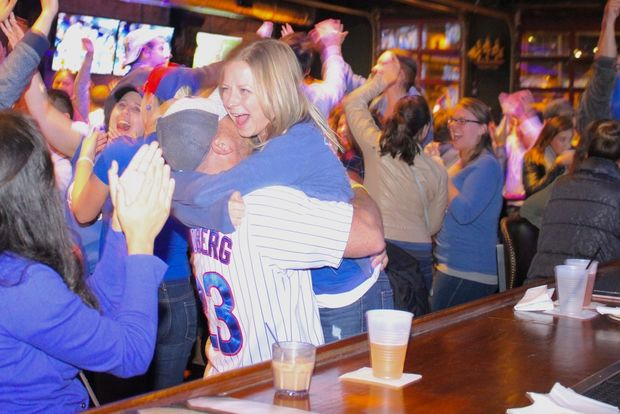Cubs fans celebrate after Addison Russell's home run gave the Cubs the lead in Game 5 of the NLCS.