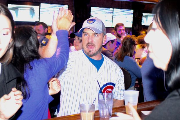 Cubs fans celebrate during the Cubs' NLCS Game 5 against the Dodgers on Thursday.