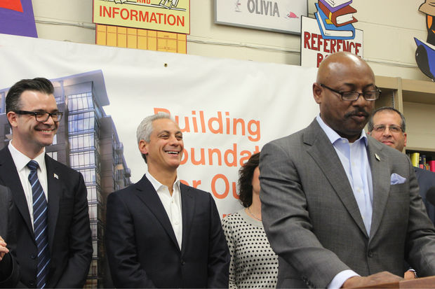Eugene Jones, CEO of the Chicago Housing Authority, speaks about the new mixed housing-library developments, while Library Commissioner Brian Bannon and Mayor Rahm Emanuel look on.
