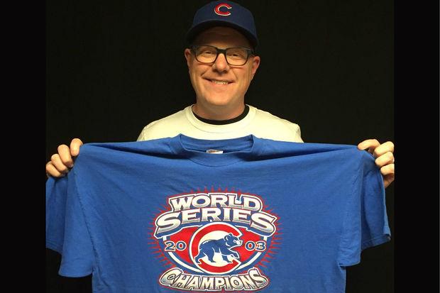 Corey Fineran holds a 2003 Cubs World Series champions T-shirt he found at a 150971f9e0a1