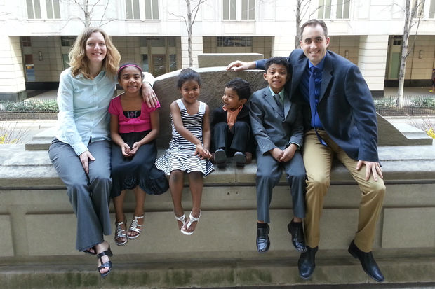 Kevin and Katina Yohpe with their four adopted children, who are all siblings: Darniel, Jaylyn, Daisy and Jeremiah.